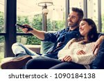 cheerful couple watching tv... | Shutterstock . vector #1090184138