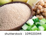 Healthy Amaranth grains with chopped cucumber and chick peas. - stock photo