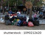 migrants sit on november 13 ... | Shutterstock . vector #1090212620