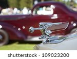PLYMOUTH - JULY 29 : A vintage hood ornament at the Concours D'Elegance  July 29, 2012 in Plymouth, Michigan. - stock photo