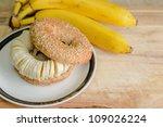 Bagel with sliced banana - stock photo