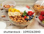 bowl of homemade granola with... | Shutterstock . vector #1090262840