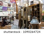 Small photo of St Ives, Cornwall, UK - April 13 2018: Colourful homeware and decorative items for sale on shelves in a fancy goods store