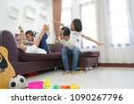 happy asian family in living... | Shutterstock . vector #1090267796