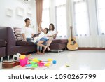 happy asian family in living... | Shutterstock . vector #1090267799