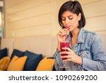 beautiful young woman drinking... | Shutterstock . vector #1090269200