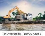 tracked excavator loading soil...   Shutterstock . vector #1090272053