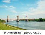 Small photo of A beautiful red oud bridge, river Old Maas in Spijkenisse in Sputh Holland