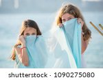 two young girls covering their... | Shutterstock . vector #1090275080