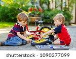 two happy little kid boys... | Shutterstock . vector #1090277099