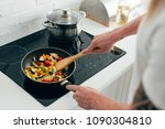 cropped shot of man cooking... | Shutterstock . vector #1090304810