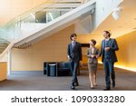 business persons walking in the ... | Shutterstock . vector #1090333280