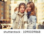 two happy young fashion girls... | Shutterstock . vector #1090339868