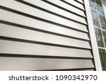 vinyl siding on a new home | Shutterstock . vector #1090342970