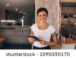 portrait of a smiling coffee...   Shutterstock . vector #1090350170