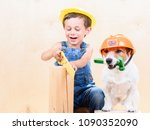 kid and dog wearing hardhats... | Shutterstock . vector #1090352090
