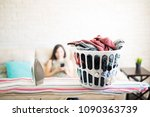 laundry basket with iron on...   Shutterstock . vector #1090363739