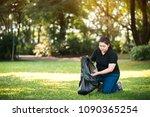 young volunteer picking up... | Shutterstock . vector #1090365254