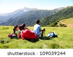 family laying down the grass...   Shutterstock . vector #109039244