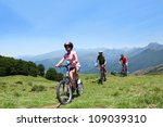 family riding bikes in the...   Shutterstock . vector #109039310