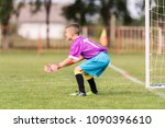 little goalkeeper used hands... | Shutterstock . vector #1090396610