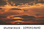 sunset with dark clouds in... | Shutterstock . vector #1090414640