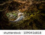 inside a cave looking out... | Shutterstock . vector #1090416818