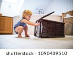 toddler boy with a laundry... | Shutterstock . vector #1090439510