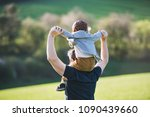a father giving toddler son... | Shutterstock . vector #1090439660