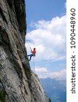 male rock climber abseiling off ...   Shutterstock . vector #1090448960