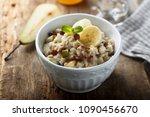 bircher muesli or homemade... | Shutterstock . vector #1090456670