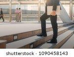 businessman holding a laptop... | Shutterstock . vector #1090458143