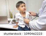 pediatrician is diagnosing... | Shutterstock . vector #1090462223