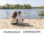 a happy young couple of... | Shutterstock . vector #1090463294