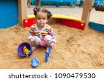 a little girl with two tails is ...   Shutterstock . vector #1090479530