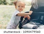 a little girl is rolling baby...   Shutterstock . vector #1090479560