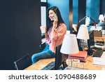 smiling asian female employee... | Shutterstock . vector #1090488689