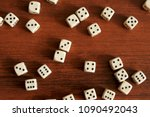 dice are scattered on a wooden... | Shutterstock . vector #1090492043