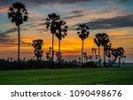 sugar palm tree in twilight | Shutterstock . vector #1090498676