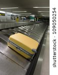 Airport carousel with a suitcase - stock photo