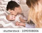 young parents with baby on bed... | Shutterstock . vector #1090508006