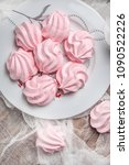 pink meringue cookies on wooden ... | Shutterstock . vector #1090522226