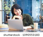happy young asian woman working ... | Shutterstock . vector #1090553183
