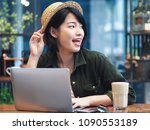 happy young asian woman working ... | Shutterstock . vector #1090553189