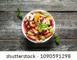 fresh fruit salad  top view in... | Shutterstock . vector #1090591298