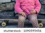 a beautiful little girl fell on ... | Shutterstock . vector #1090595456