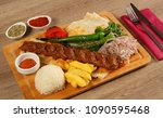 turkish adana kebab on the wood ... | Shutterstock . vector #1090595468