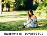 young woman using a smartphone... | Shutterstock . vector #1090599506
