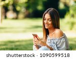young woman using a smartphone... | Shutterstock . vector #1090599518