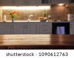 blurred kitchen interior and... | Shutterstock . vector #1090612763